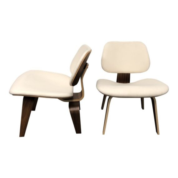 Herman Miller Eames Upholstered Molded Plywood Dining Chairs  A Pair.  Original Price: $4,268.00